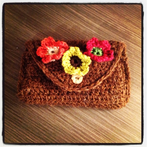 Crocheted pouch with flowers