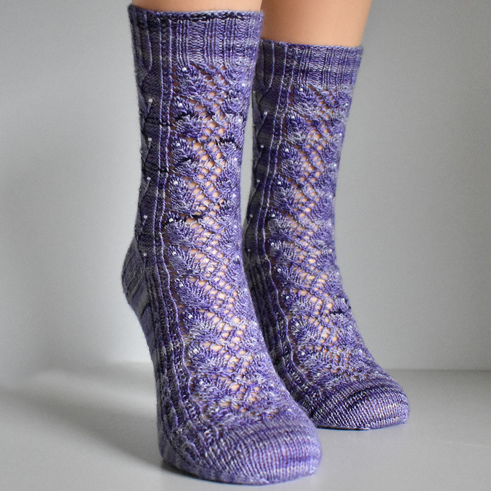 Elvenpath socks by Dots Dabbles with cables and lace