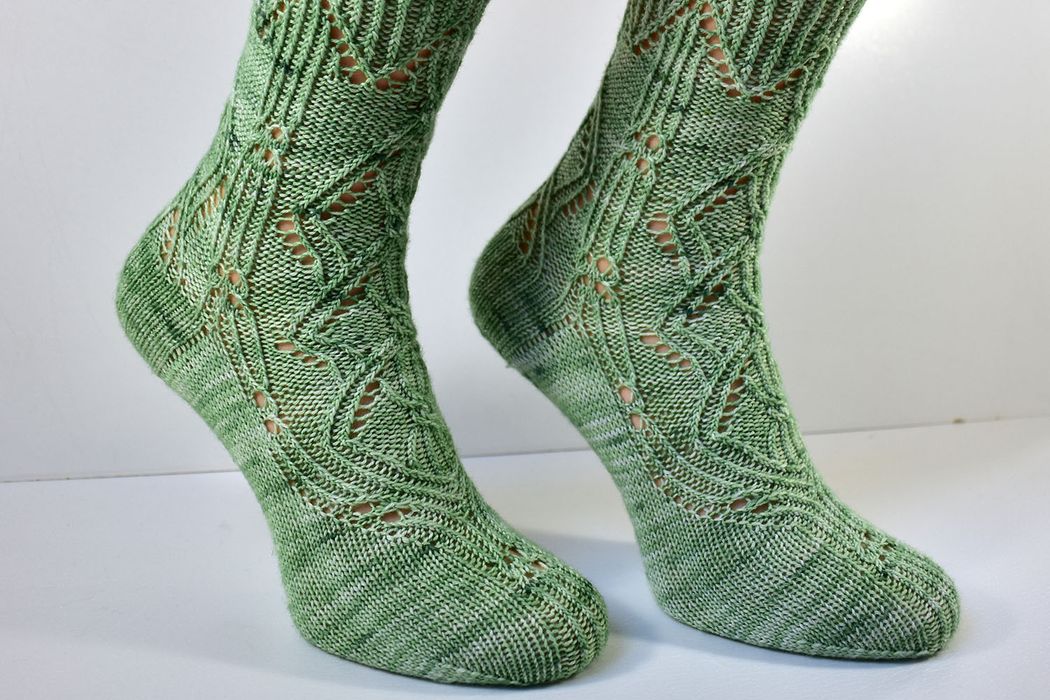 Side detail of Triforium sock pattern with cables and lace
